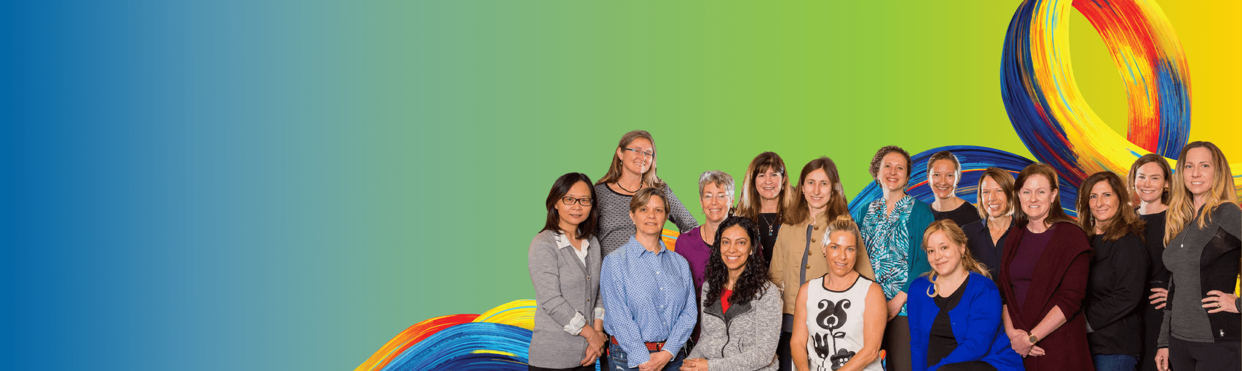 Group Picture of Female Faculty in front of the surge and a gradient blue to yellow background