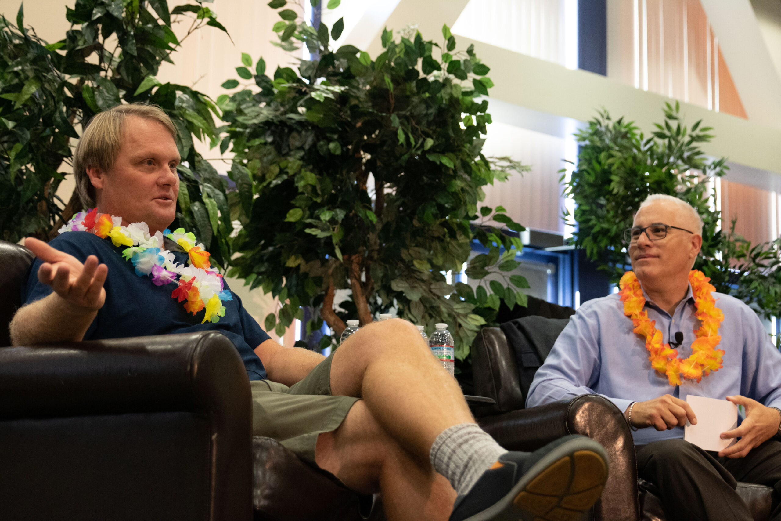 Picture of Biotech entrepreneur Charlie Dunlop sitting on a couch with a lei around his neck