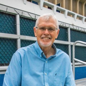 Professor James Hicks stands next to the Crawford pool at UC Irvine.